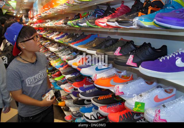 Hong Kong China Kowloon Mong Kok Fa Yuen Street Sneaker Street shopping fashion athletic shoe store inside sale - Stock Image