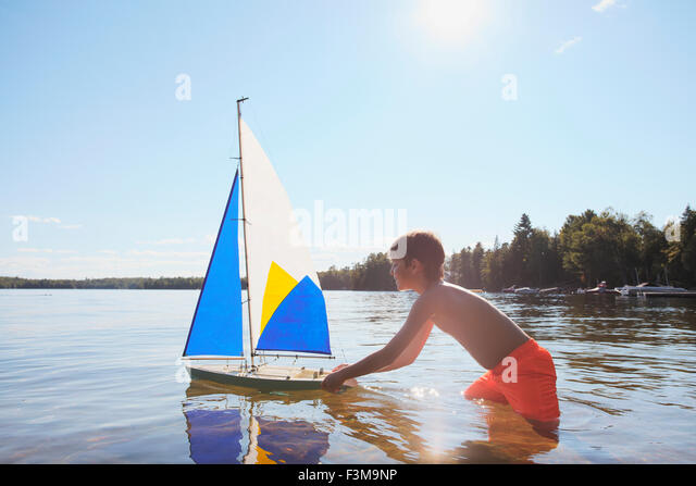 Lake Toys For Boys : Dog boat boy stock photos images alamy
