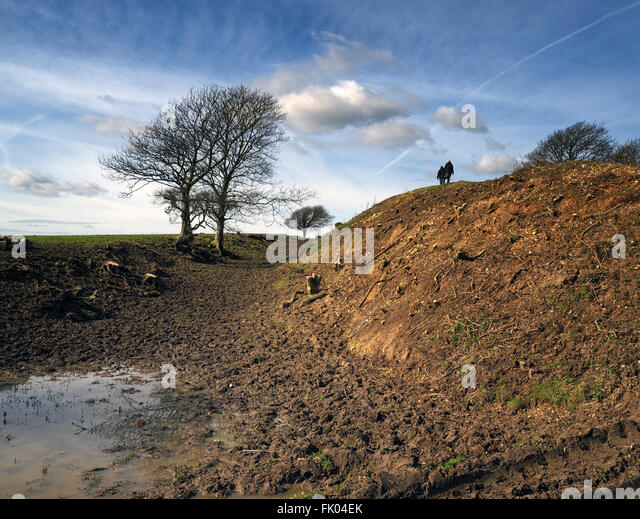 A couple take a stroll in the countryside near Devil's Dyke, South Downs, Sussex - near Brighton - Stock Image