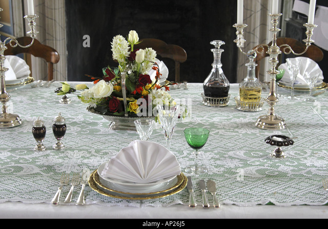 Victorian dining table setting stock photos victorian for Edwardian table setting