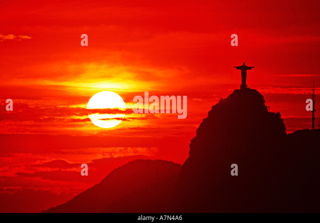 Brasil Rio de Janeiro Corcovado Hill Christ Statue Cristo Redentor on top at sunset, view from sugarloaf mountain - Stock Image
