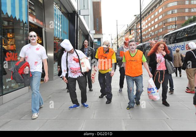 Oxford Street, London, UK. 12th October 2013. Zombies start their walk  through central London. Credit:  Matthew - Stock Image