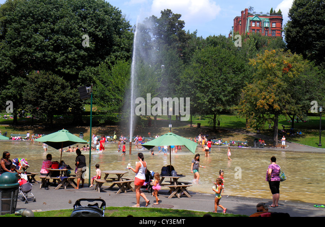 Boston Massachusetts Boston Common public park Frog Pond fountain water families summer activity children playing - Stock Image