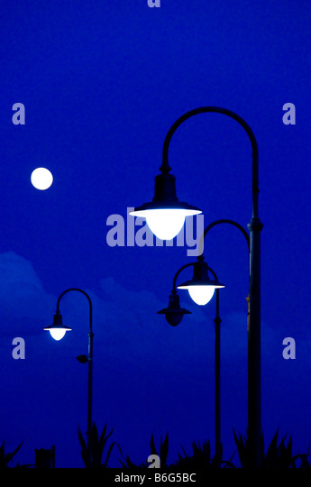 Street lamps at dusk. - Stock Image
