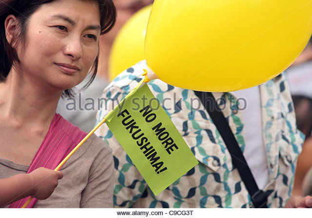 A family holding a 'No More Fukushima!' sign protests nuclear power at the 'Energy Shift Parade' - Stock Image
