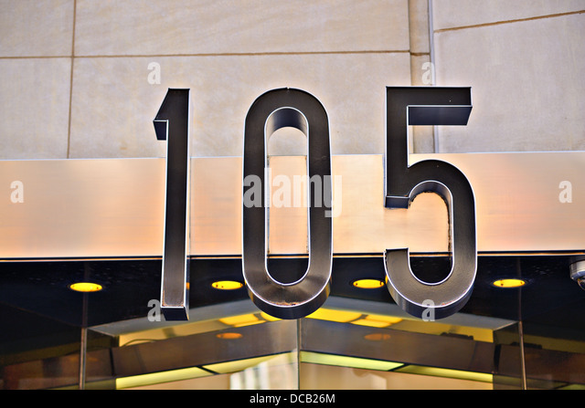 Building address number 105. - Stock Image