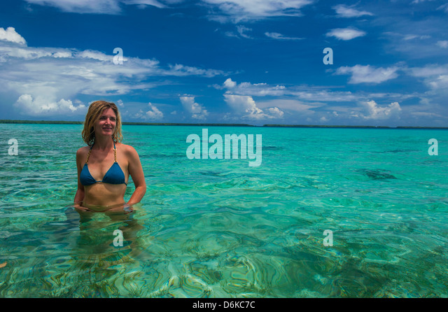 Tourist in the incredible blue waters of the Ant Atoll, Pohnpei, Micronesia, Pacific - Stock Image