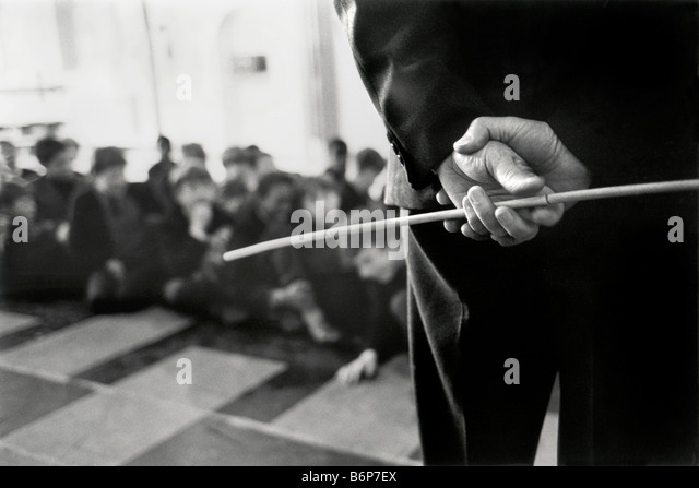 hands of teacher holding cane in the schoolclass - Stock-Bilder