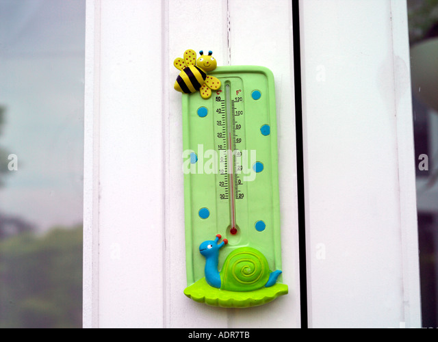 Thermometer Measuring over 70 Degrees with Fahrenheit and Centigrade - Stock Image