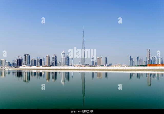View across The Creek towards skyline of Dubai and Burj Khalifa at Business Bay in United Arab Emirates - Stock-Bilder