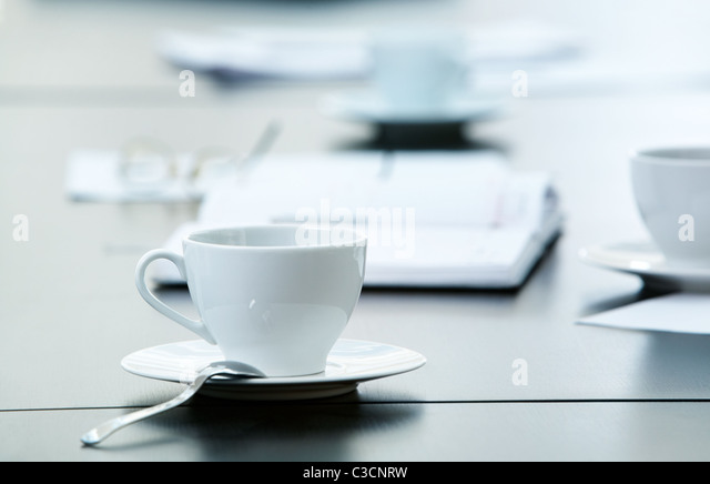 Morning workplace: cup of coffee and business objects on the table - Stock Image