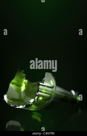 broken bottle (bottleneck) used by some very violent people in order to hurt or kill. - Stock Image