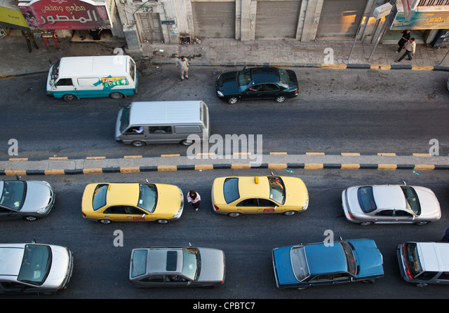 Road traffic seen from above in central Irbid, Jordan - Stock Image