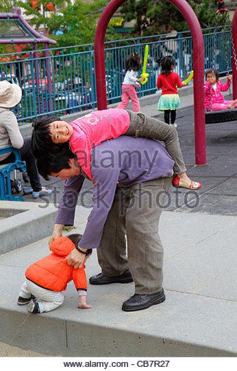 San Francisco California Chinatown Portsmouth Square Park ethnic neighborhood community fair event Asian man boy - Stock Image