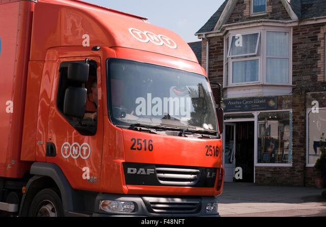 Orange TNT Delivery Lorry - Stock Image