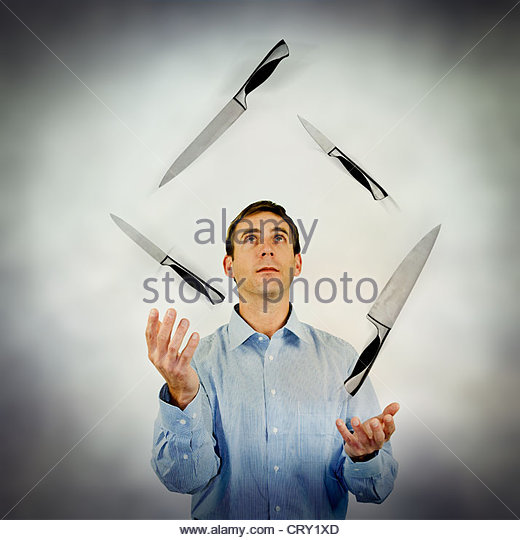 knife juggling - Stock Image