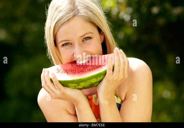 Girl eating Melon - Stock Image