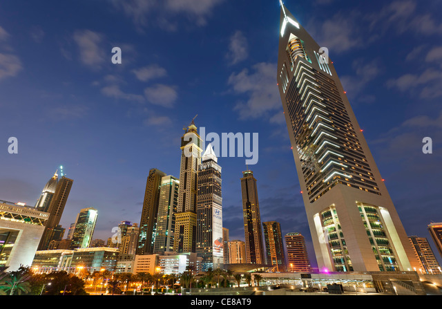 Dubai, Emirates Towers and Skyscrapers at Dusk - Stock Image