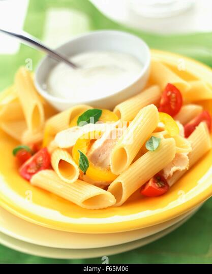Penne pasta with chicken and white sauce - Stock Image