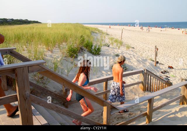 Massachusetts Cape Cod Nauset Beach Cape Cod National Seashore dune grass sand sunbathers teen boy girl Atlantic - Stock Image