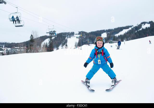 Smiley little boy (5) at ski resort - Stock Image