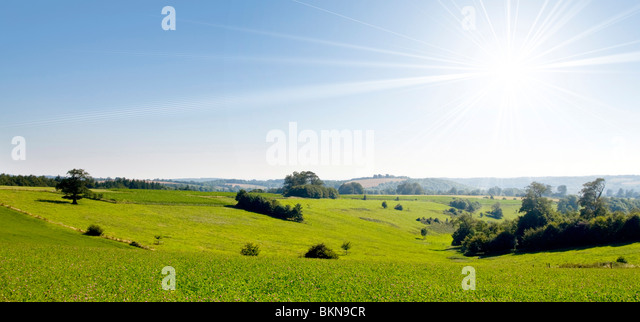 Bright sun over countryside - Stock Image