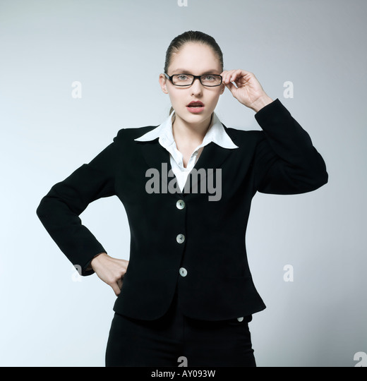 studio shot portrait of a beautiful young angry woman in a costume suit - Stock Image