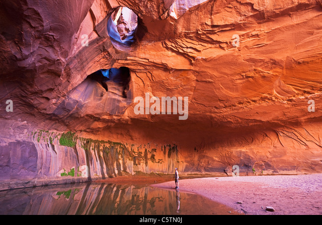 USA, Utah, Grand Staircase-Escalante National Monument, Neon Canyon, Tourist in Golden Cathedral - Stock Image