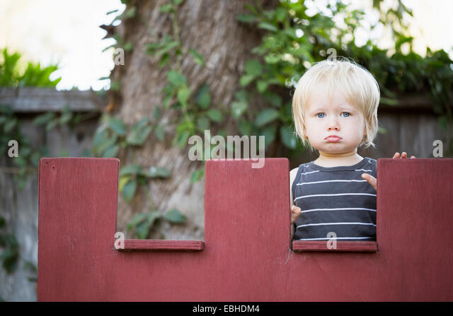 Young boy sulking - Stock Image