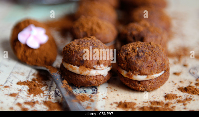 Filled chocolate cookies (Baci) - Stock Image