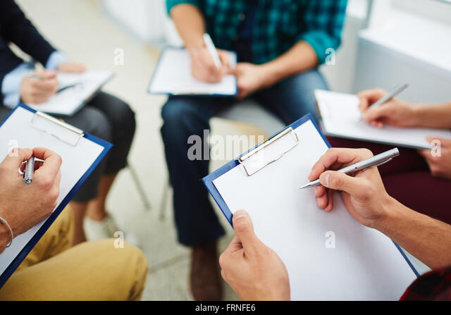Writing down ideas - Stock Image