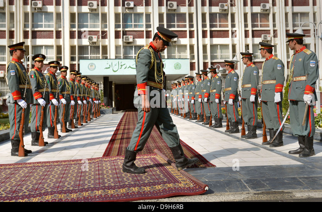 A member of the Afghan Army honor guard rolls out red carpet as they prepare for the arrival of Deputy Secretary - Stock Image