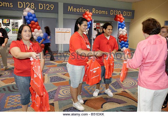Miami Beach Miami Florida Beach Convention Center Hispanic Heritage Month Expo demographic volunteers woman women - Stock Image