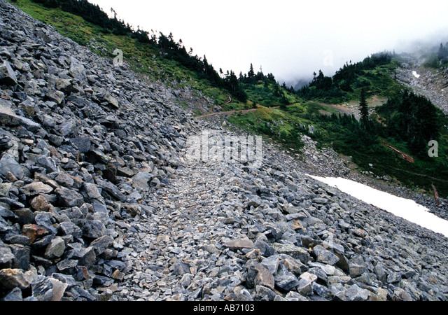 Hiking trail through a rock scree on the Cascade Pass trail North Cascades National Park Washington COPYRIGHT DUANE - Stock Image