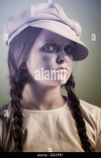 a naughty and dirty girl with a cap - Stock Image
