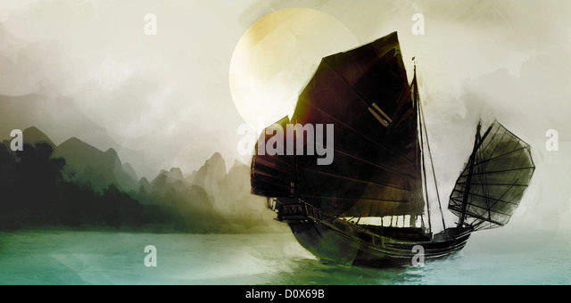 Silhouette of Junk boat sailing on turqouise sea at sunset - Stock Image