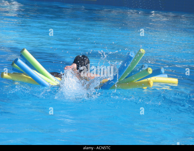 Swimming pool monster stock photos swimming pool monster for Chicken in swimming pool