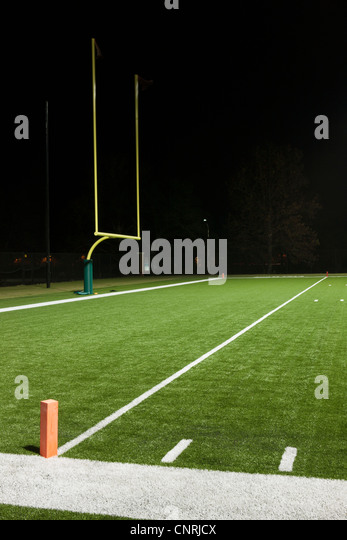 Goal post on empty football field - Stock Image