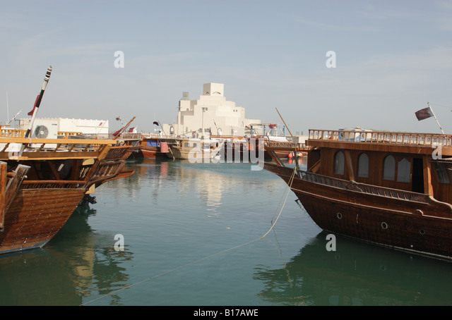 View across the dhow harbour towards the Museum of Islamic Art in Doha,Qatar, build by the architect I.M.Pei. - Stock Image