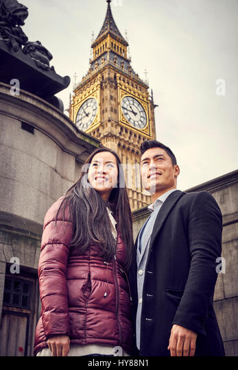 A young Japanese couple sightseeing in London - Stock Image