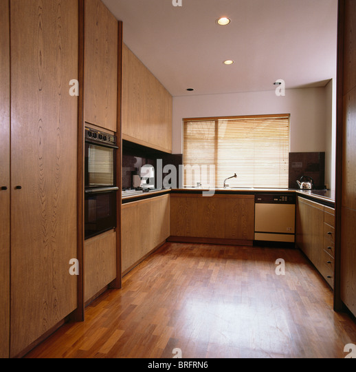 Fitted cupboards stock photos fitted cupboards stock for Wooden fitted kitchen