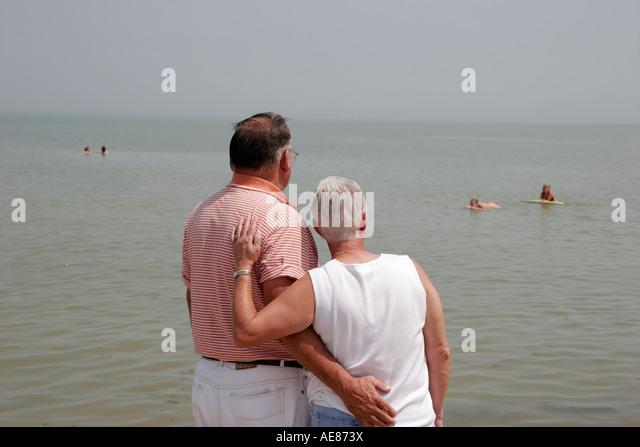 Toledo Ohio Oregon Maumee Bay State Park Lake Erie couple man woman swimmers - Stock Image