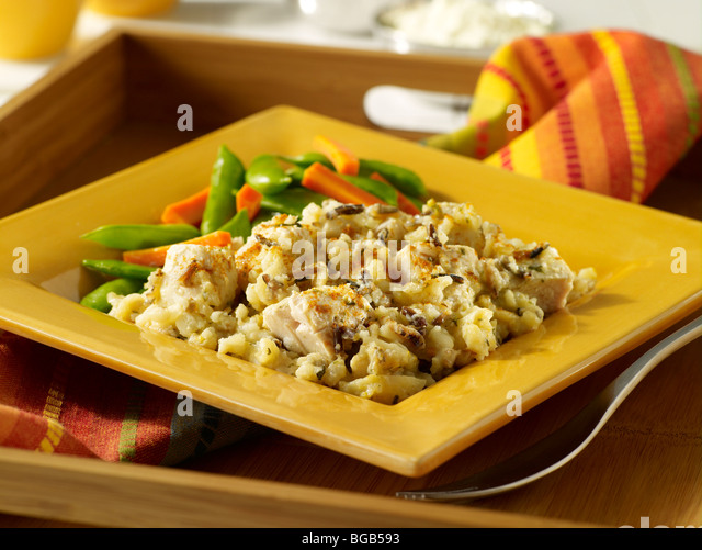 Chicken and wild rice casserole with vegetables - Stock Image