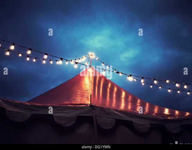 Circus Tent and String of Lights at Night, Low Angle View - Stock-Bilder
