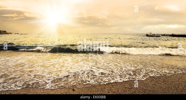 Beautiful evening sun and clouds over the sea - Stock Image