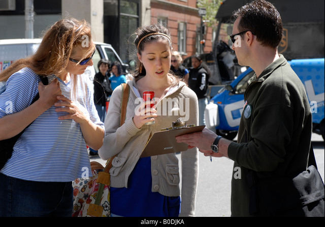 Volunteer at Earth Day collects signatures on petition - Stock Image