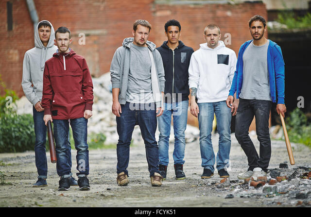 Group of hooligans looking at camera outdoors - Stock Image