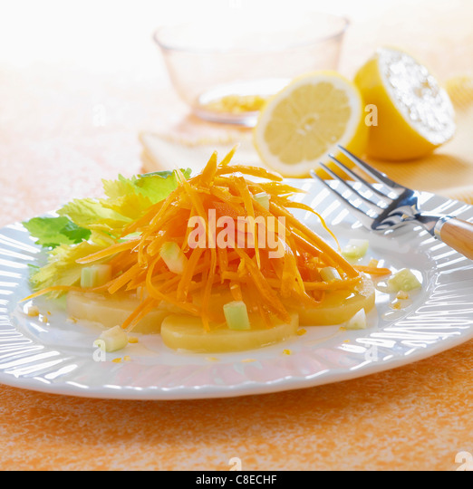 Grated carrots and potato salad with lemon juice - Stock Image