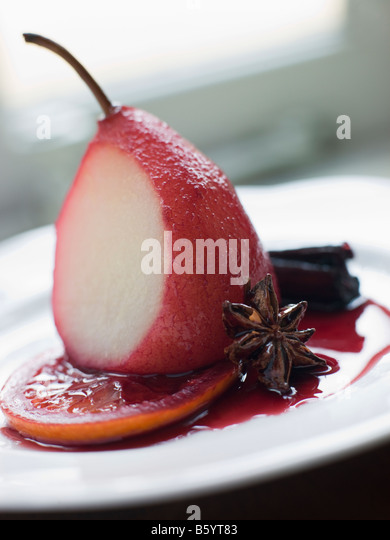 Pear Poached in Rioja Orange and Spices - Stock Image