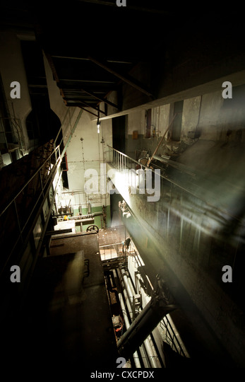 Abandoned power station, 3rd level at night - Stock Image